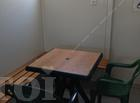 Office container with benches, table and chairs