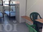 Ofifice container with beds, wardrobe, bench, table and chairs