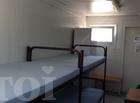 Ofifice container with beds, wardrobe, bench and table